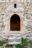 Stairs and door ina stone wall Royalty Free Stock Images