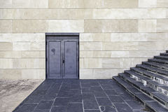 Stairs and door in modern building Royalty Free Stock Image