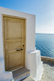 Stairs and door which go down to sea of Santorini Royalty Free Stock Photography
