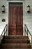 Stairs and doors (muted). Stairs and doors to historic church building in muted or earthy color tones stock image
