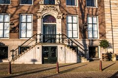 Stairs and doors and old row houses in Amsterdam. Sunny morning in the old town of Amsterdam with details of architecture Stock Photo
