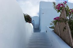 Stairs down in the beautiful city of Oia on Santorini island Royalty Free Stock Photos