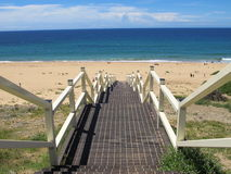 Stairs down to the beach 2. Stairway leading down to the beach on a sunny day Royalty Free Stock Image