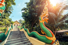 Stairs with dragons to the Thai temple. Wat Patong Suwankeereewong Temple Phuket, Thailand. Royalty Free Stock Photos