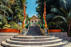 Stairs with dragons to the Thai temple. Wat Patong Suwankeereewong Temple Phuket, Thailand. Stock Photo