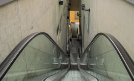 Stairs of the escalator leading down Stock Images