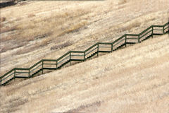 Stairs and fence in a field. A field with stairs and a field Stock Images