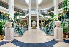 Stairs with forged handrails. In the hotel hall royalty free stock images
