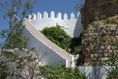 Stairs of Frigliana. Spain. White walls on blue sky Royalty Free Stock Images