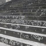 Stairs. Full frame abstract background showing some old lichen-overgrown stairs royalty free stock photo