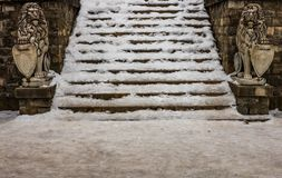 Stairs full of snow at the entrance of Peles Castle in Sinaia, Romania. royalty free stock photos