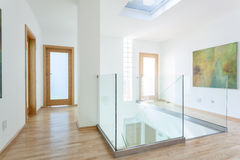 Stairs, glass banister and doors in modern hallway. On the attic Royalty Free Stock Photography