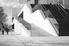 STAIRS. GOING UP-OUTDOORS -GLASS BANISTER-BLACK AND WHITE- DISABLED RAMP Royalty Free Stock Image