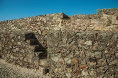 Stairs going up to pathway over a thick wall in Marvao royalty free stock photography