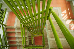 Stairs with green bars. Up side view of stairs with green bars Royalty Free Stock Photography