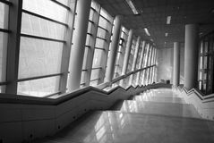 Stairs in the hall. With large windows Stock Photos