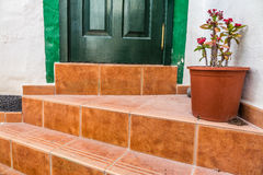 Stairs and home door. Stairs to and doors to one of homes of Puerto de Mogan, a small fishing port in Gran Canaria, Canary Islands, Spain Royalty Free Stock Image