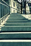 Stairs II (Europe). Stairs lead the way to another part of town... (grungy tint Royalty Free Stock Image