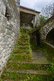 The stairs in the inner yard of the house. The stairs in the inner yard of the ruined and abandoned house in the Godinje village at Montenegro Royalty Free Stock Photo