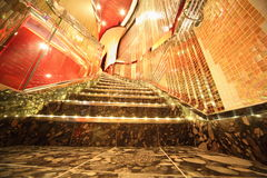 Stairs inside illuminated hall of Costa Deliziosa Royalty Free Stock Photo