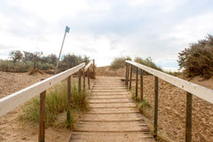 Stairs lead to the top of the dunes. Stock Image