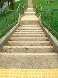 Stairs leading down. Concrete staircase leading down the hill Royalty Free Stock Photo