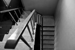 Stairs leading down. Black and white photo of the stairs leading down royalty free stock photography