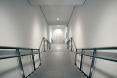 Stairs leading down to emergency exit Stock Image