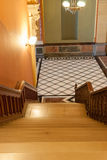 Stairs leading down to tiles diamond pattern floor in French Ren Stock Image