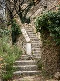 Stairs leading to he entrance of an old stone house. In Croatia Island Cres Royalty Free Stock Images