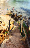 Stairs leading to the rock on Mirissa beach, Sri Lanka Royalty Free Stock Photography