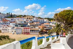 Stairs leading to the sandy beach surrounded by typical white houses, Carvoeiro, Algarve, Portugal stock image
