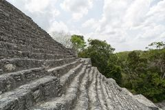 Stairs leading to the top of pyramid at Calakmul Mexico stock photo
