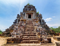 Stairs leading to top of temple-mountain of Ta Keo, Angkor. Stairs leading to top of temple-mountain of ancient Ta Keo. Amazing Angkor, Siem Reap, Cambodia. Blue Royalty Free Stock Images