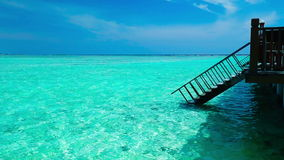 Stairs leading to tropical lagoon on tropical Maldives island with tourquise clear water stock footage