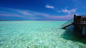Stairs leading to tropical lagoon on tropical Maldives island with tourquise clear water stock video footage