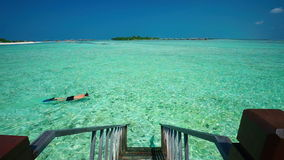 Stairs leading to tropical lagoon on tropical Maldives island with tourquise clear water. Stairs leading to tropical lagoon with crystal clear water on tropical stock video footage