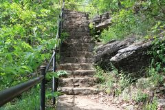 Stairs leading up to level ground stock photo