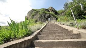 Stairs leading up to a rock stock video