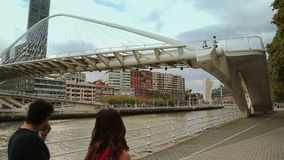 Stairs leading up to walkway, footbridge across river connecting two city banks. Stock footage stock footage