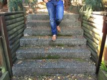 Stairs with legs in jeans Royalty Free Stock Photography