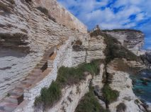 Stairs in the limestone wall. Corsica Island, Bonifacio, France.  stock photo