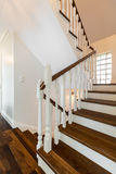 Stairs of luxurious storey house. Vertical photo of wooden stairs in a luxurious storey house royalty free stock photography