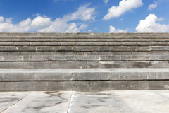 Stairs made of concrete, close-up. Photographed close-up stairs to the street. The structure is made of concrete slabs. In the background, blue sky with clouds Royalty Free Stock Images