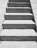 Stairs made of gray granite stone goes up. Perspective view stock image