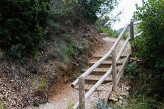 Rock stairs to trek the hill with wooden reiling stock photography
