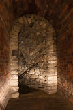Stairs in medieval castle. Stairs in medieval dungeon, dark passage Royalty Free Stock Images