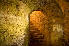Stairs in medieval cellar. Stairs in dark medieval cellar stock photography