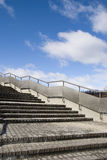 Stairs with metal handrails. Stairs to city building with metal handrails on a background of blue sky Royalty Free Stock Photos