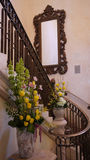 Stairs and mirror. Grand staircase and mirror with flowers Stock Image